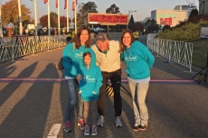 People posing at the start/finish line of We Promise Foundation race