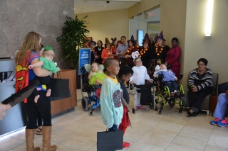 Kids and adults in costumes for Halloween Spooktacular at Chartway Credit Union
