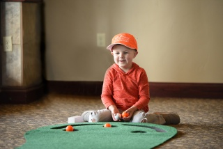 Little boy playing golf
