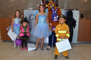 We Promise heroes and their siblings at Chartway's headquarters in Virginia Beach to trick-or-treat.