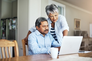 Hispanic couple on laptop computer