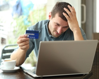 man worried over maxed out credit card