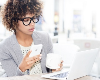 woman researches how to choose a credit card online