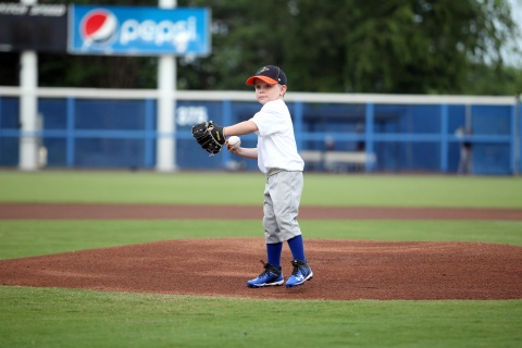 Little boy throwing first pitch