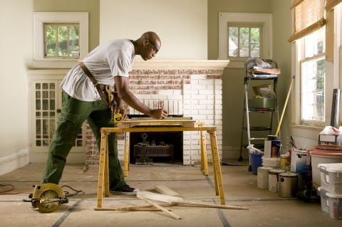 African American Male Fixing His Home