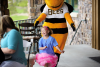 Brinley buzzing about the Putting For Promises Golf Tournament with Utah Bees mascot Bumble the Bee