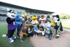 Group of mascots Make A Wish kid and baseball player