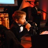 We Promise Hero, Gideon, hits the gavel during the Gala's live auction