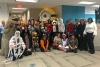 group photo of kids and Chartway employees in costumes for the We Promise Spooktacular 2017